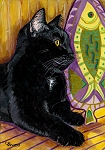 Brock - black cat with golden eyes next to a fish platter